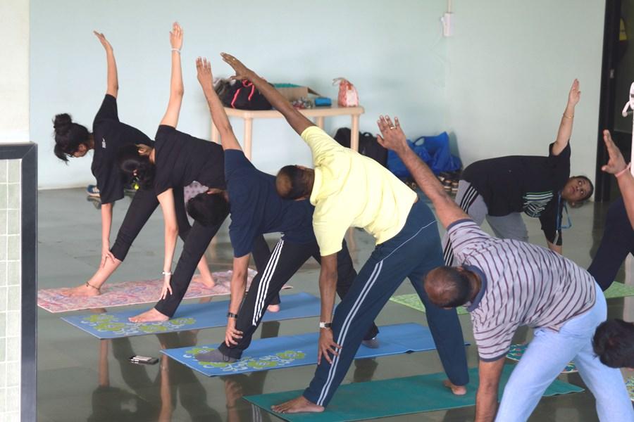 Male Employees Doing Yoga