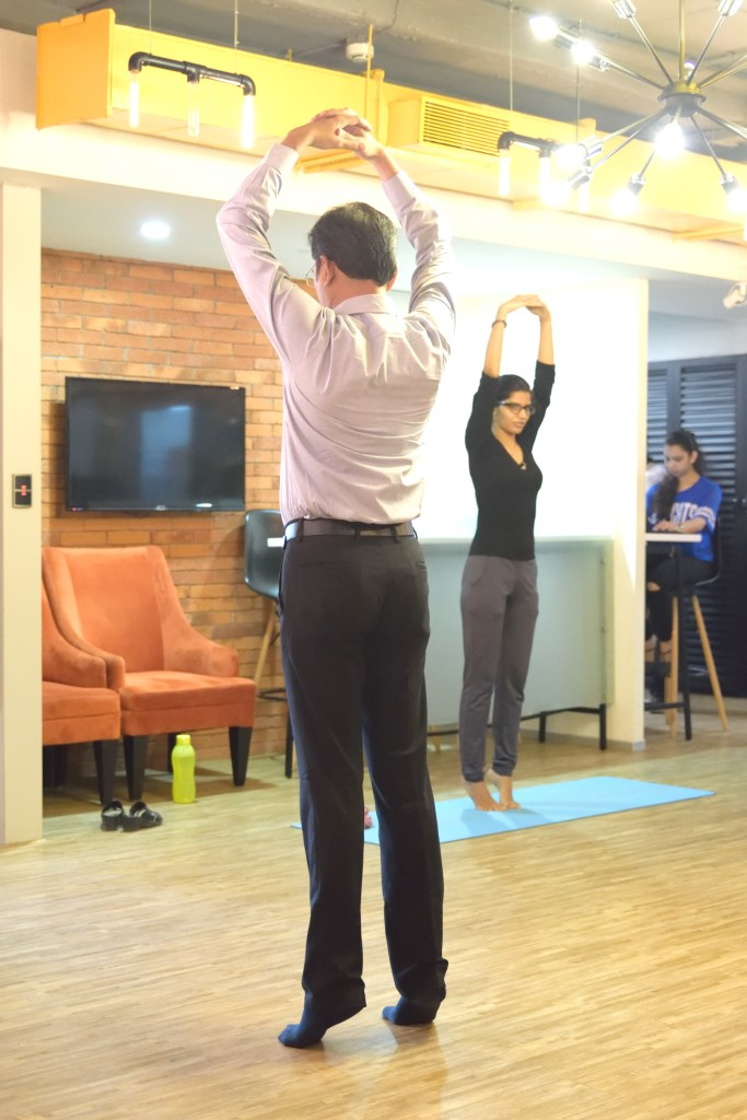 Employees Stretch at Office