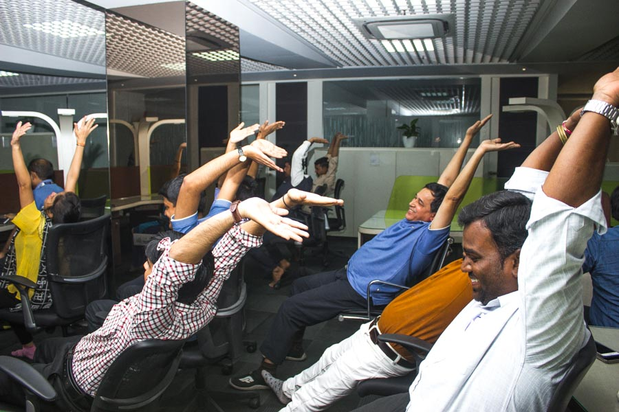 Corporate Employees Doing Yoga