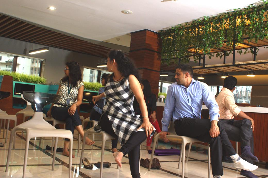 Employee yoga at company