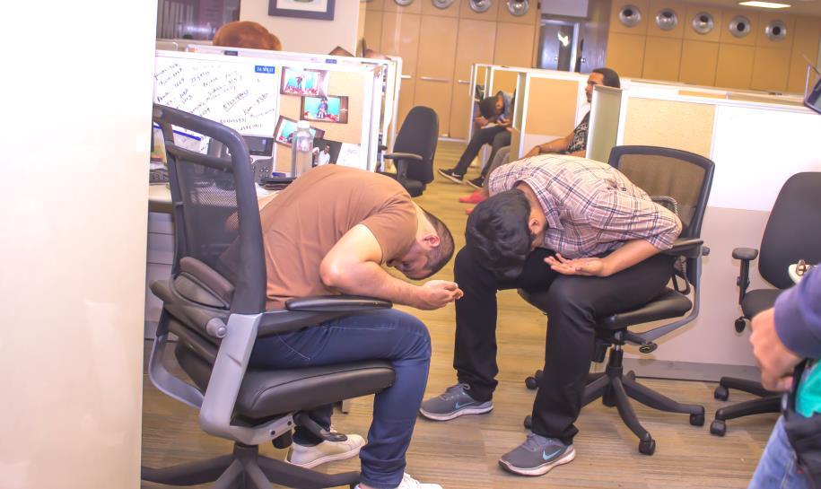 Office Employees Doing Yoga